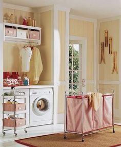 another laundry room to covet...love those giant clothespins!