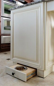 Second Wind Interior Design- small dog feeding station that pulls out from under the cabinet #home #decor