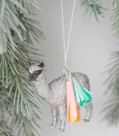 paperstitchblog- tasseled animal ornaments for the boy's tree! Get inexpensive plastic animals- spray paint/glitter & tassel for more color.