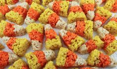 Candy Corn Mini Rice Krispie Treats - bite-sized Rice Krispie Treats that look just like Candy Corn. Easy to make and boy do they taste great!