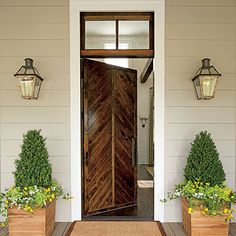 The chevron design of the wood door dates back centuries. Besides looking great, it's also a practical choice. The pattern keeps the door stable and sheds water to prevent warping.