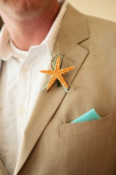 Star fish boutonniere. Perfect for a #beach #wedding!