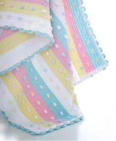Baby blanket with pom pom
