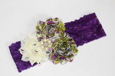 This is such a sweet headband for a little one! It has purple flowers and a white flower on a purple lace elastic headband. It would go with