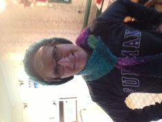 Me wearing the matching hat and scarf I knitted.