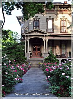 Town and Country Living: The Historic Streets of Sycamore, Illinois  I love it! The doors are beautiful and so inviting. The colors are neutral and I absolutely adore the architectural design over the entry, windows, and just below the roof. Gorgeous!