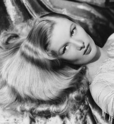 """100 Years of Down-to-There Hair  Veronica Lake: 1941. The same article also included the precise measurements of Lake's hair: """"The hair varies in length from 17 inches in the front to 24 inches in the back and falls 8 inches below her shoulders."""""""