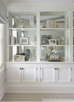 in bookcase Mirror, Mirror on the Shelves! Very cool way to enlarge a space.Mirror, Mirror on the Shelves! Very cool way to enlarge a space. Living Room Shelves, Living Room Decor, Kitchen Shelves, Built In Cupboards Living Room, Alcove Ideas Living Room, Wall Cabinets Living Room, Living Rooms, Room Divider Bookcase, Living Room Built Ins