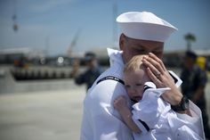 A sailor assigned to amphibious transport dock ship USS Green Bay (LPD 20) embraces a child at a homecoming ceremony at Naval Base San Diego. Green Bay returned from deployment to the Western Pacific region with amphibious assault ship USS Peleliu (LHA 5), amphibious dock landing ship USS Rushmore (LSD 47), and embarked 15th Marine Expeditionary Unit.  Read more: http://www.dvidshub.net/image/931596/uss-green-bay-lpd-20-homecoming#.UZOsyYJAtal#ixzz2TNQ6j3N5