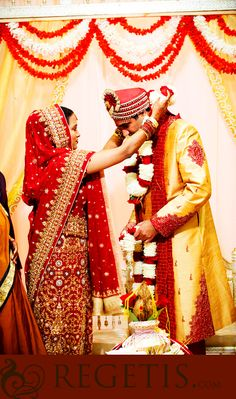 Indian Wedding Photographs at Marriott in Gaithersburg Maryland : bride garlanding her groom