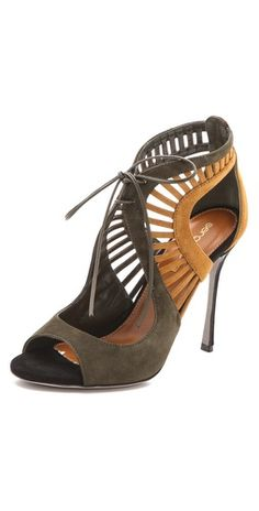 FREE SHIPPING at shopbop.com. Velvety two-tone suede composes these Sergio Rossi sandals, which cut a sexy silhouette with cutout detailing and a lace-up closure. Covered stiletto heel and leather sole. Leather: Calfskin. Made in Italy. MEASUREMENTS Heel: 4.25in / 110mm - Cargo