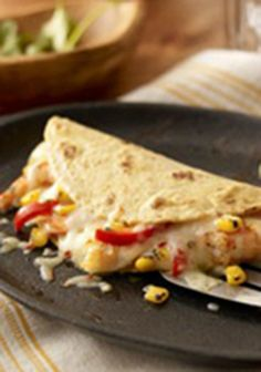 Chile-Lime Shrimp Quesadillas — What's the best flavor combination? After trying these shrimp quesadillas, you'll think it's cilantro, lime, chili, and pepper jack cheese—and we can't argue with you!