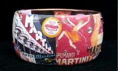 With a Twist Vintage Martini Poster Art Bracelet by Wearabella, $45.00. Shaken, not stirred.