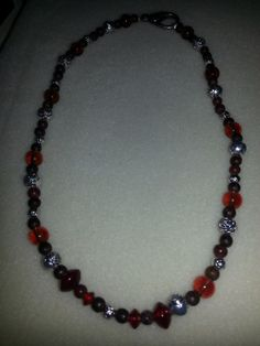 brown hues mixed with silver-$15