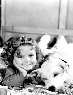 A vintage press shot of Hollywood legend Shirley Temple and friend, circa
