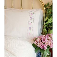 """Brighten anyone's day with flowers! These beautiful crewel embroidery Hydrangeas Pillow Cases are perfect for the guest room or for gift giving. Finished Size: Set of 2: 20"""" x 30"""" each (51 x 76 cm). Package contains two polyester/cotton pillow cases stamped in wash-away ink, and easy instructions with a thread shopping list. Needle and thread not included."""