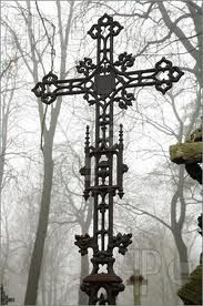 iron cross in old cemetery