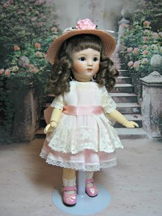 Loulotte  Little LuLou wears her dress made from antique wedding hankie with a pink underdress.
