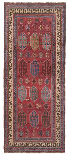 BORDJALOU KAZAK, Southeast Caucasian, 5ft 1in x 12ft 0in, 2nd Quarter, 19th Century. This important tribal rug presents an extraordinarily rare design of which there is only one published example, in the book by pre-eminent rug scholar, Ulrich Schurmann, Oriental Carpets (1966). Both pieces are clearly the work of pastoral nomads, using a portable loom that was collapsed and then reassembled when the tribe moved between its winter and summer grazing grounds.