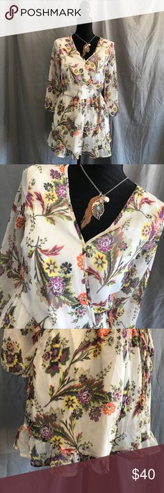 """Band of Gypsies Sheer Floral Romper Pockets S Band of Gypsies Floral romper.  Pockets, Ruffle bottom.  Size small. Sheer sleeves and back.  Snap surplice front. Faux tie side. Keyhole back button.  EUC except for two small pen marks that blend with the print, pictured. Length is 14"""" waist to hem.  B4 Band of Gypsies Dresses"""