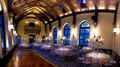 """With its 40-foot vaulted ceilings, Gothic stained-glass windows and crystal chandeliers, the Great Hall at the <a href=""""http://www.travelchannel.com/interests/top-hotels/photos/america-most-luxurious-mansion-hotels?page=11"""">Castle Hotel"""