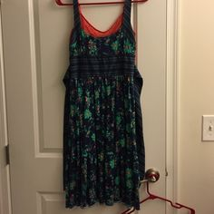 Free People dress with Camisole Navy Free People dress (size 10) with Free People camisole (size medium). I would say this dress runs 2 sizes small. I normally wear about a size 4-6 so I listed as a 6. Runching and sash in back. Sold as a set.  No fading. Only worn twice. Free People Dresses Midi