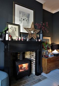 Christmas mantle, Christmas lounge, black walls, farrow and ball railings. Dark Living Rooms, Cottage Living Rooms, New Living Room, Living Room Decor, Log Burner Living Room, Living Room With Fireplace, Lounge Decor, Farrow Ball, Christmas Lounge
