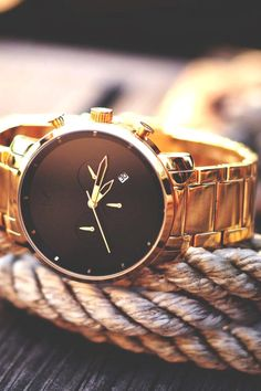 Define your style with MVMT's Chrono Black/Gold Watch
