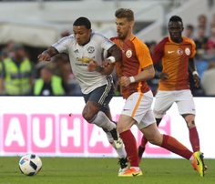 Memphis Depay of Manchester United in action with Serdar Aziz of Galatasary during the preseason friendly match between Manchester…