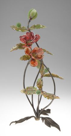 Standing Poppy by Loy Allen. Flameworked glass poppy and leaves, with forged metal stem and leaf stand.