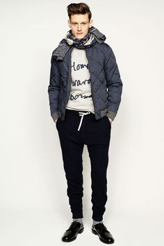 Opt for a navy quilted bomber jacket and navy sweatpants to effortlessly deal with whatever this day throws at you. Throw in a pair of black leather derby shoes to show your sartorial savvy.  Shop this look for $133:  http://lookastic.com/men/looks/scarf-crew-neck-sweater-bomber-jacket-sweatpants-socks-derby-shoes/5796  — Charcoal Scarf  — Grey Print Crew-neck Sweater  — Navy Quilted Bomber Jacket  — Navy Sweatpants  — Grey Socks  — Black Leather Derby Shoes