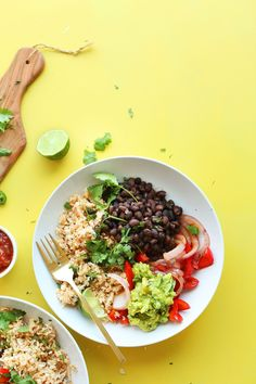 Flavorful 30-minute burrito bowls made with seasoned cauliflower rice, black beans, grilled peppers and onions, and guacamole! Hearty, plant-based fun.