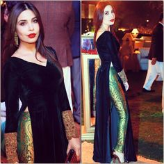 Maheen Taseer Bottle green velvet shirt with a back motif and worked sleeves- paired with banarsi pants