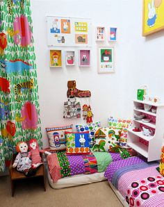 Polly's room by Jane Foster. Love the Miffy prints, bright colours and toddler-friendly lounging area.
