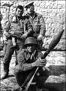 Soviet war in Afghanistan: Three Soviet soldiers. Photos taken by conscripts time and again show their friends brandishing guns and grenade-launchers.