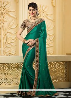 Glorious green satin silk designer saree with embroidery, resham, zari, lace and patch border work. As shown an unstitched blouse comes with this.(Slight variation in actual color is possible)....