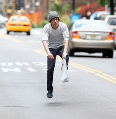 Jesse Eisenberg strolling through town. | Celebrities Riding Invisible Bikes Is Weirdly Hilarious