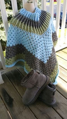 Hot Off My Hook! Project: Cowl-Neck Poncho Started: 18 Aug 2015  Completed: 21  Aug 2015 Model: Madge the Mannequin Crochet Hook(s): 7mm Yarn: Redheart Super Saver  Color(s): Light Blue, Grey Heather, Frosty Green Pattern Source: Simply Crochet Magazine Issue No. 25 Pattern Designed By: Simone Francis Notes: This is my 19th Cowl-Neck Poncho! I had a bout of insomnia and was able to finish this one quickly! I was inspired by my Gray Ugg Boots and a purse in my closet!