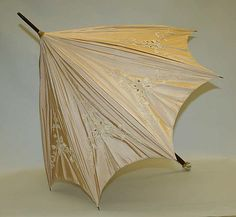Parasol Date: 1875–1925 Culture: American or European Medium: silk Dimensions: Length: 36 in. (91.4 cm) Credit Line: Gift of Mr. & Mrs. O. D. Filley, 1995 Accession Number: 1995.341.9