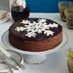 Let this elegant chocolate cheesecake be the centerpiece of your holiday tablescape featuring a gorgeous White Chocolate Snowflake in the center. Chocolate Truffle Cheesecake - Southern Living