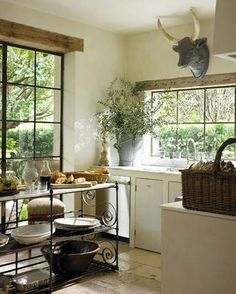 rustic bulls head galvanized pots and french cutting boards Pamela Pierce country kitchen