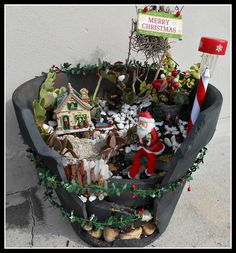 christmas themed miniature fairy garden with santa hollies and a cracked pot fantastic