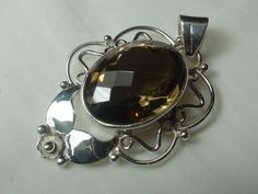 Very large hand made  pendant - oval faceted smoky quartz set in sterling silver #Handmade #Pendant