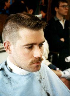 At his barbers