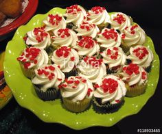 Cupcakes decorated with tiny maple leaves for Canada Day.