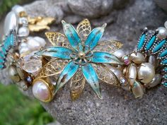 """""""Texas Turquoise"""" Bracelet made from vintage earrings and brooches with freshwater pearls and silver and gold-plated findings (toggle clasp, rings, and headpins).    Designed and constructed on 8.26.09 by @Laura Gracey (me!)."""