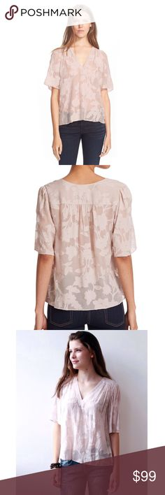 """Rebecca Taylor Top A square silhouette is softened with a magnolia clip detail on a sheer backdrop. V-front, gathers at shoulders and back yoke lend a fluid fit, subtle high-low hem. Showcase this gorgeous top over pants, jeans, shorts or tucked in a skirt.  Loose fitting blouse. Best Fit : Size 8 - 10  24.5"""" length  Short sleeves. Sheer; base layer recommended. 100% silk with 54% cotton, 46% silk contrast. Rebecca Taylor Tops Blouses"""