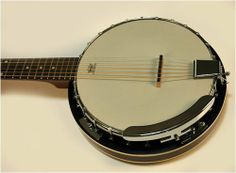 """NEW BANJITAR GUITJO 6 STRING BANJO FOR GUITAR PLAYERS by Banjitar. $199.99. I have seen quite a few of these 6 string banjos of various brands. This one combines all the best features. No corners cut and great tone. Quality Gears, Remo Head, 24 bracket, arm rest, mahogany resonator and much more. The nicest 6 string banjo I have had to offer under 00! o Six String Banjo o 24 Bracket o Remo Head o Arm Rest o Rosewood Fingerboard o Dot Inlay o 22 Frets o 1 11/16"""" N..."""