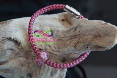 Limited edition Ropelet in pink and black with a Murano glass bead and stainless steel locking clasp, See all the Ropelets the handmade rope bracelets at www.ropelet.co.uk. Let the rope free