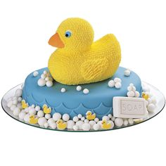 A 3-D Rubber Ducky Pan cake paddling atop an Oval Pan cake is sure to make a splash at your next party or shower. Add white fondant bubbles and bar soap to strengthen the bath-day connection.
